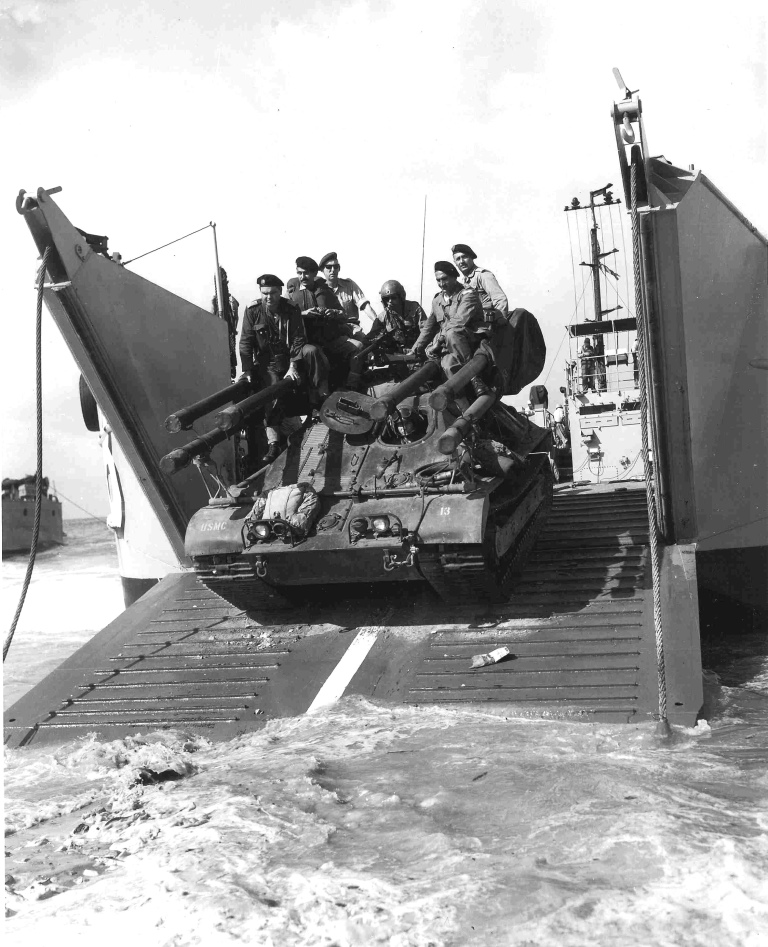 U.S. Marines and Lebanese Army personnel debark from the LCT (Landing Craft Tank) with one of the Marine Corps new ONTOS.  Lebanese soldiers expressed keen interest in this manual vehicle with its six 106mm recoilless rifles mounted on their own self-propelled chassis.  Lebanon 1958. USMC Photo